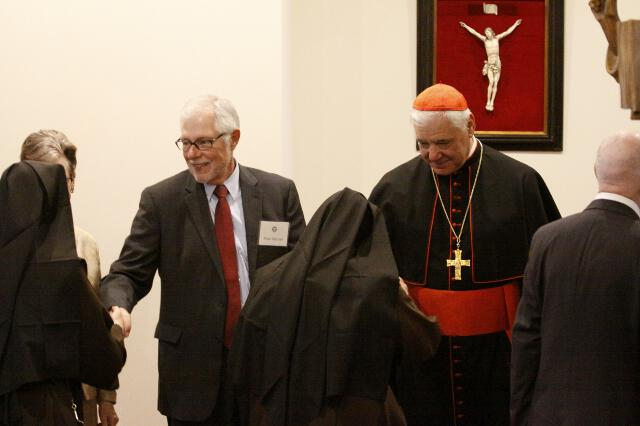 Dr. McLean and Cardinal Müller greet guests in St. Bernardine of Siena Library