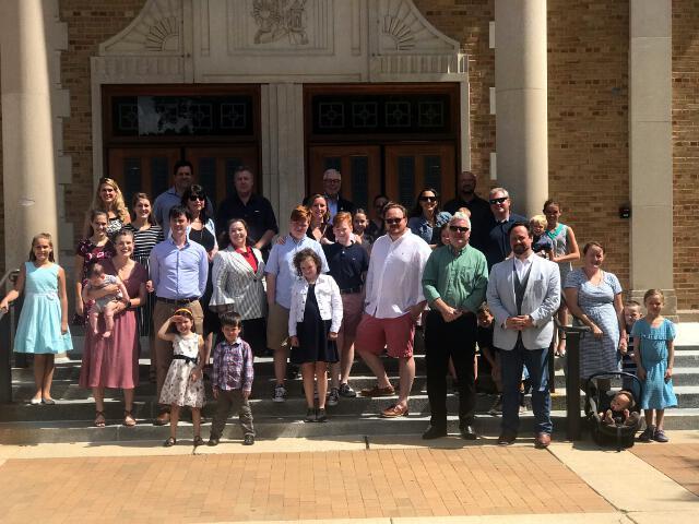 Alumni pose outside St. Isaac Jogues Parish