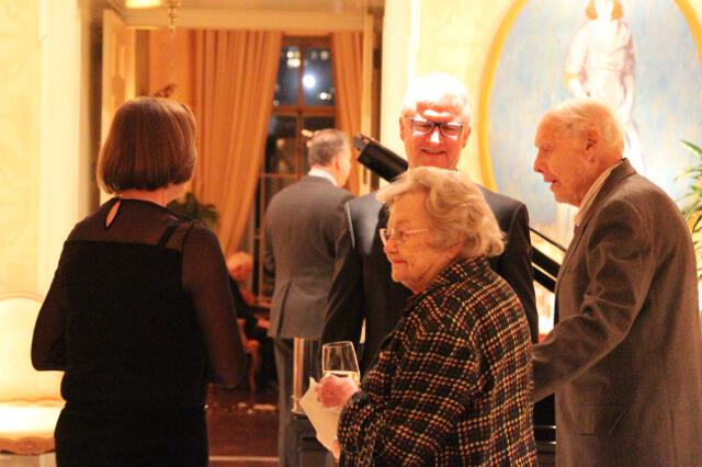 Guests mingle at the Christmas Dinner