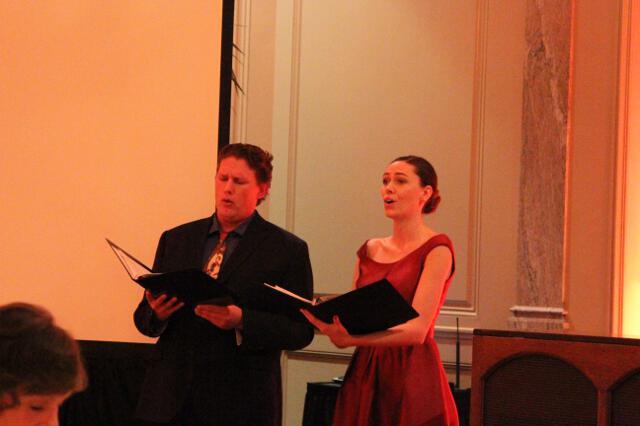 Alumni singers sing a duet