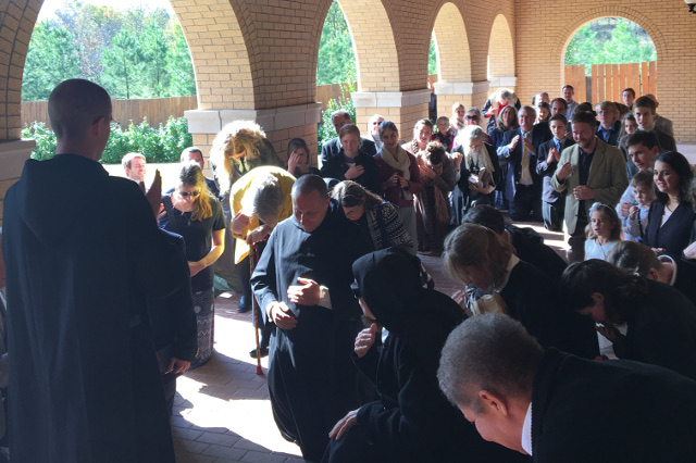Fr. Nesbit offers his first priestly blessing after the Mass.
