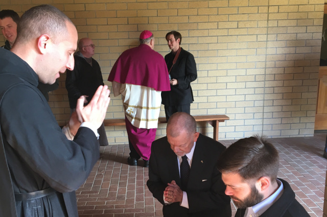 Fr. Hudson blesses Frank King ('03) and Michael Bertotti ('08).