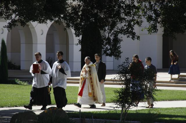 Head Chaplain Rev. Paul Raftery, O.P., leads a procession from the Chapel to the statue.