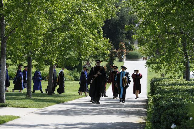 Members of the faculty process toward the Commencement ceremony.