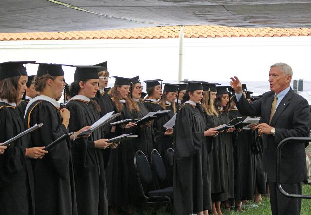 "The graduates sing the hymn, Non nobis, Domine, non nobis, sed nomini Tuo da gloriam — ""Not to us, O Lord, not to us, but to Your name give glory."""