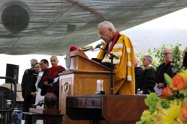 Chaplain Rev. Cornelius M. Buckley, S.J., offers the benediction.
