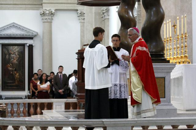 Archbishop Coakley with student acolytes