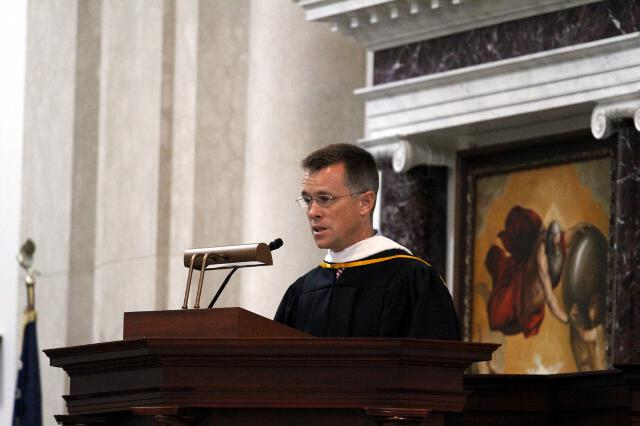 Director of Admissions Jon Daly offers the prayers of the faithful.