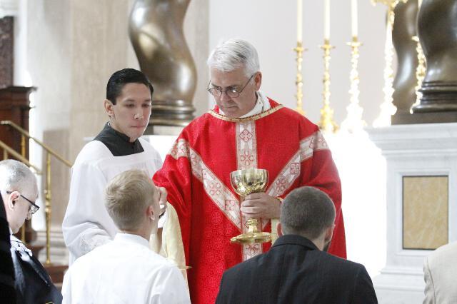 Archbishop Coakley distributes Holy Communion.
