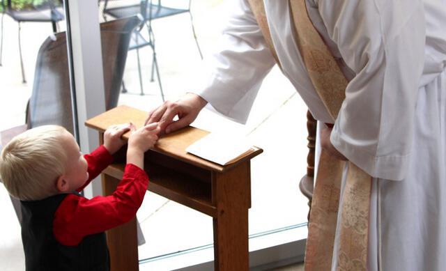Fr. Reginald blesses a little one.