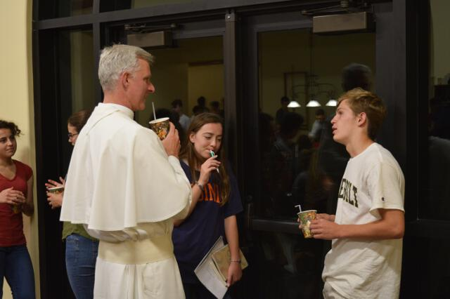 Fr. Sebastian talks to students