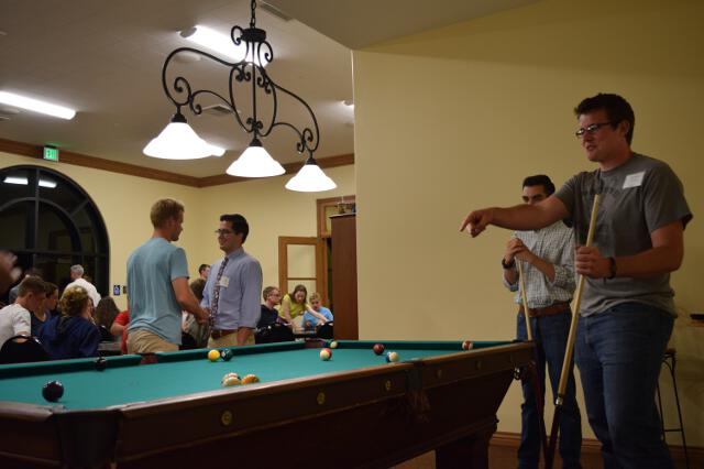 Students play pool