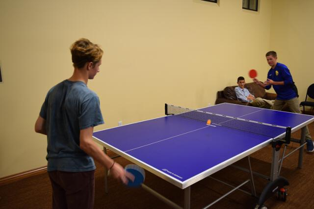 Students play ping-pong