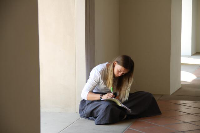 Student studies outside the Chapel