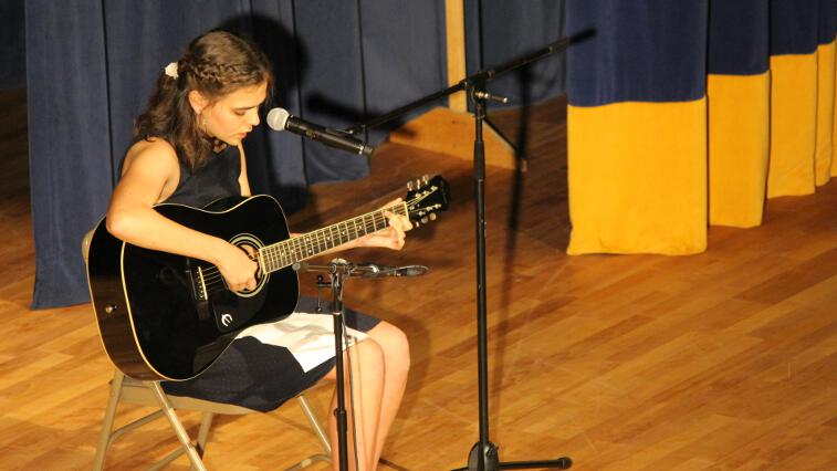 Student plays the guitar