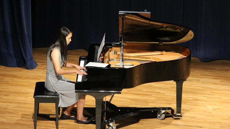 Student plays the piano