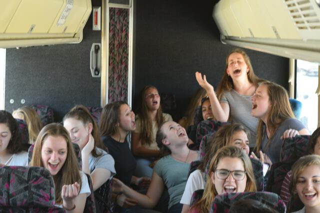 Students sing on the bus to the Getty Center