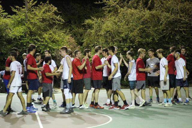 The teams congratulate each other