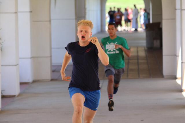 Students run around the academic quadrangle