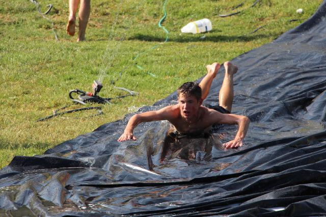 Students play on slip-n-slide