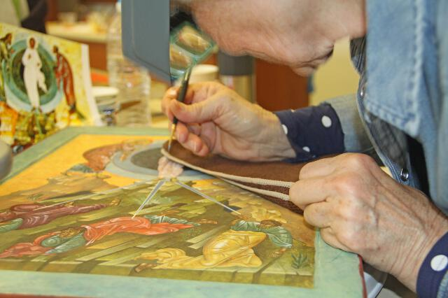 A student works on an icon