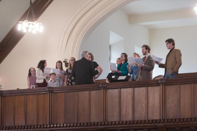 Stephen Grimm ('75) directs the choir in the chapel.