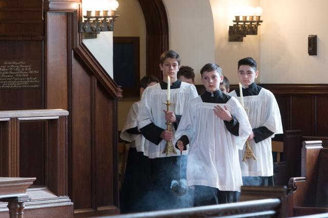 Altar servers enter the sanctuary.