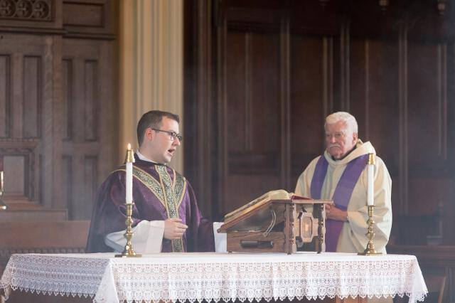 Rev. Michael Casey offers the Mass.