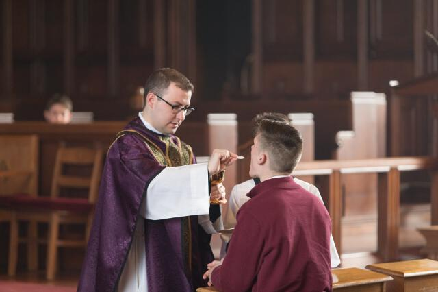 Fr. Casey distributes Holy Communion.