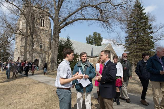 After Mass, guests visit with Admissions Director Jon Daly outside the chapel.