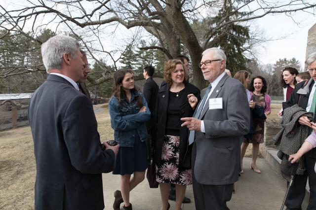 President Michael F. McLean (right) visits with Lori (Sullivan '88) and Bob Murphy ('89), graduates and the parents of two alumni and two current students.