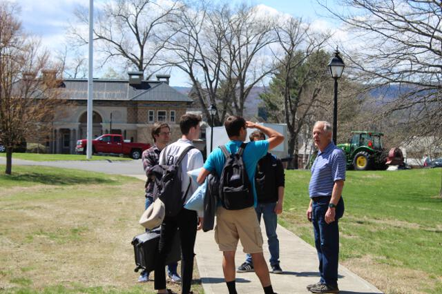 Associate Dean Tom Kaiser greets students as they arrive on campus.