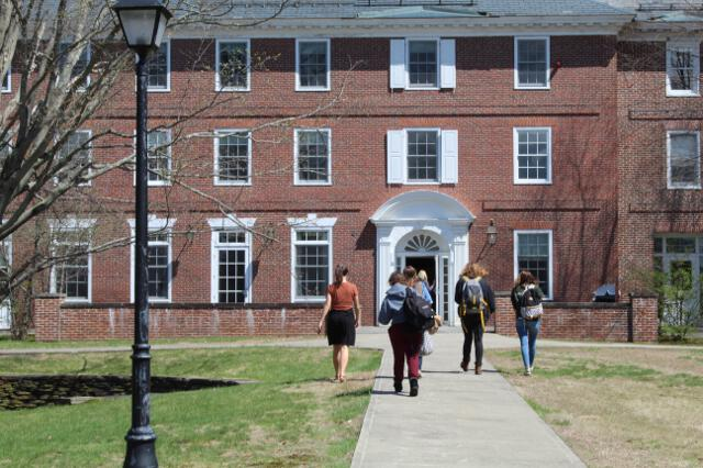 The women visit their residence hall.