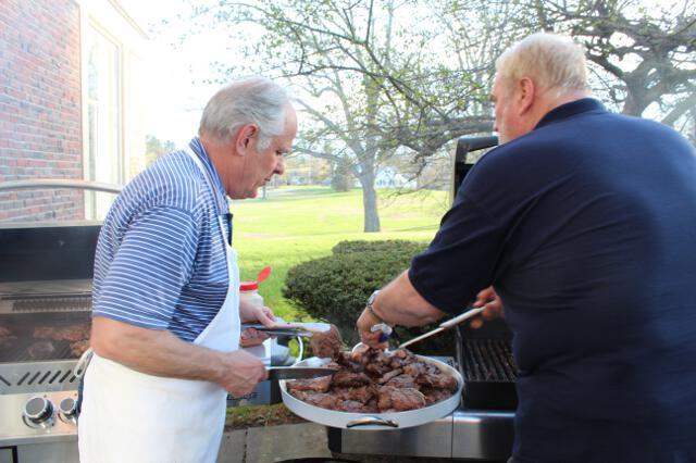 Associate Dean Tom Kaiser and Steve Wiggin prepare dinner.