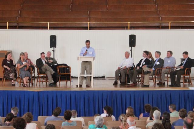 Dr. John Goyette introduces members of the faculty in Moody Auditorium.