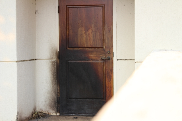 A charred doorway at St. Junipero Serra Hall