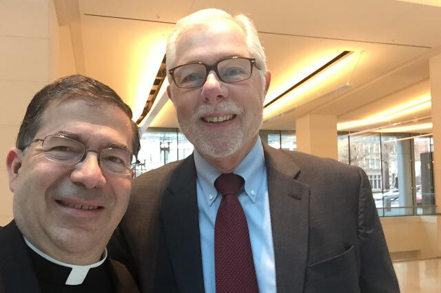 Rev. Frank Pavone, national director of Priests for Life, and President Michael F. McLean before the hearings