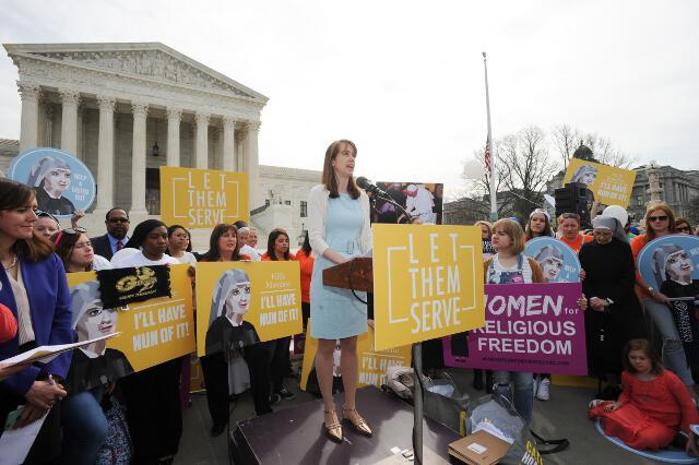 Elizabeth (McPherson '99) Claeys, chairman of the Washington, D.C., Board of Regents, speaks at the rally. (Photo: Dana Rene Bowler)