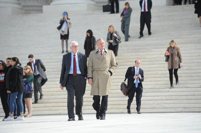 President Michael F. McLean and College Counsel Quincy Masteller descend the steps of the U.S. Supreme Court following the oral arguments. (Photo: Dana Rene Bowler)