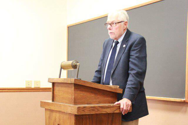 President Michael F. McLean addresses members of the Senior Class.