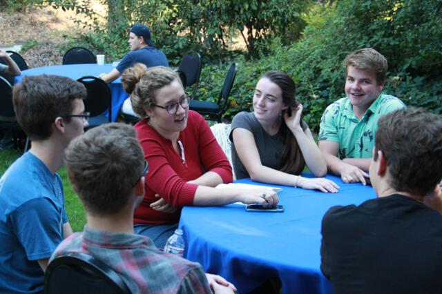 Students gather for dinner on the Hacienda lawn.