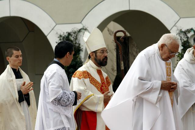 Bishop Flores, chaplains process into the Chapel