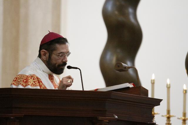 Bishop Flores delivers his homily