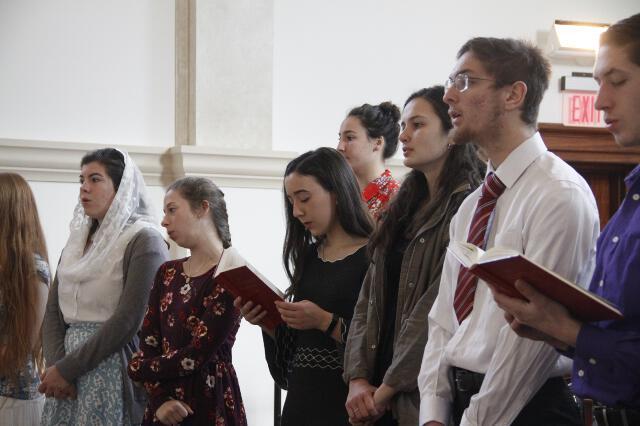 The Thomas Aquinas College Choir sings from the choir loft