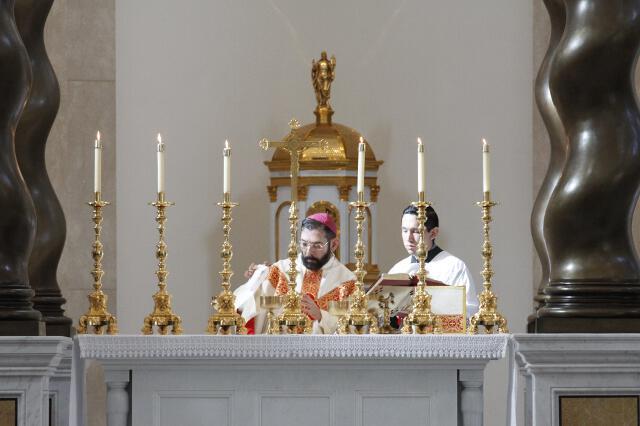 Bishop Flores prepares the altar