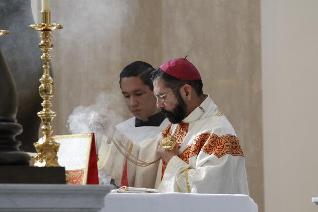 Bishop Flores incenses the altar