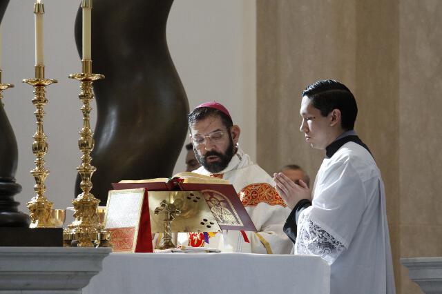 Bishop Flores at the altar