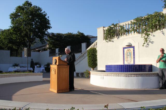 Chaplain Rev. Cornelius M. Buckley, S.J., offers the invocation