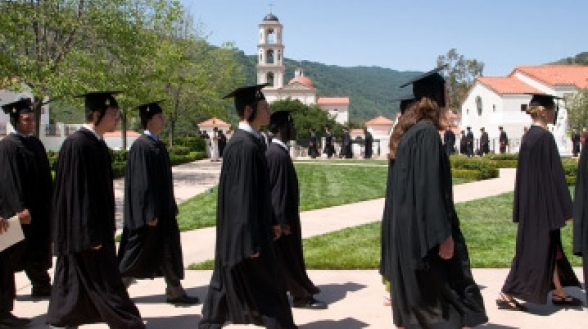 Graduates walk to Commons