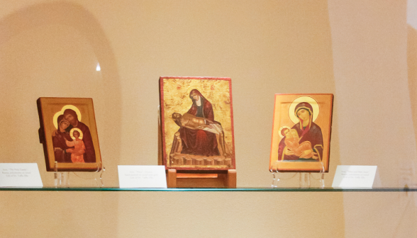 A Russian icon of the Holy Family, an icon of the Pieta from Greece, and a Russian icon of the Virgin and Child